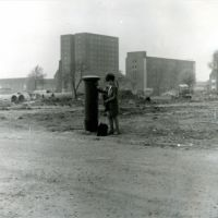 LB Barking and Dagenham, woman at a post box on the Gascoigne Estate during construction, 1970