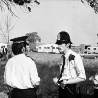 LB Brent, three police officers monitor travellers moving onto Fryent Way, 1975