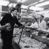LB Islington, police officer visits a butchers, 1989