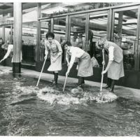 LB Haringey, Marks & Spencer's workers clear flood water in Wood Green, 1981