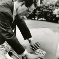 LB Hackney, the leader of the council decorates his car with a council sticker promoting the borough, 1965