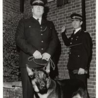 LB Bromley, a police officer unveils a plaque for Yerba, a police dog, 1984