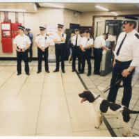 LB Haringey, police officers wait with a sniffer dog at Seven Sisters tube station, 2001