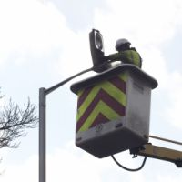 LB Croydon, a council worker repairs street lighting, c.2010